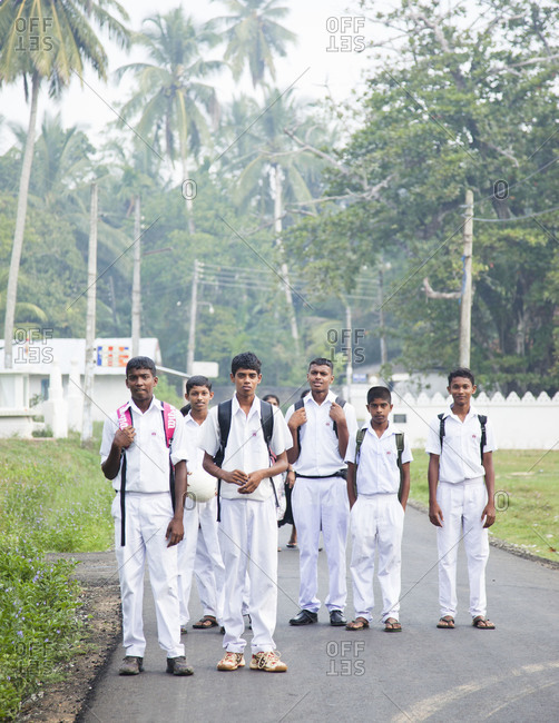 Galle, Sri Lanka - Feburary 22, 2012: Children heading to school in the morning