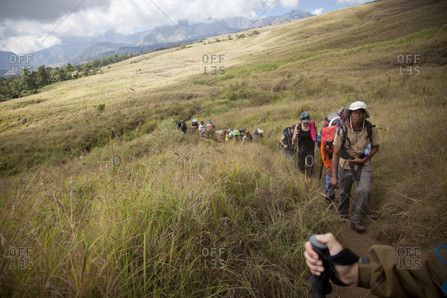August 12, 2011: Tourist group trekking up a mountain