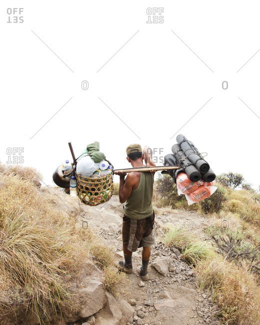Man carrying supplies at Mount Rinjani, Lombok, Indonesia