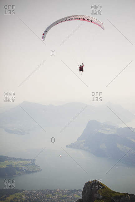 Paragliders soaring over mountains