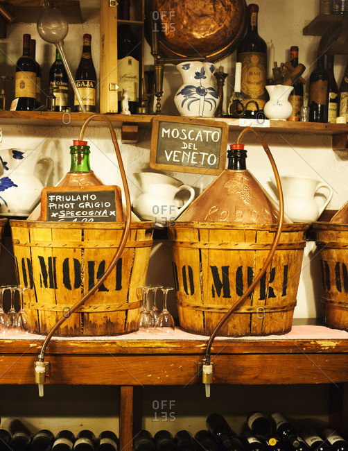 House wine stored in bottles in Italian tavern