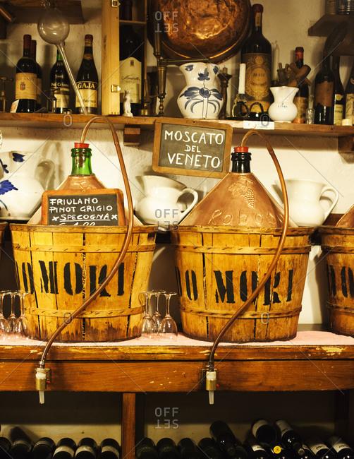 House wine stored in bottles in Italian tavern