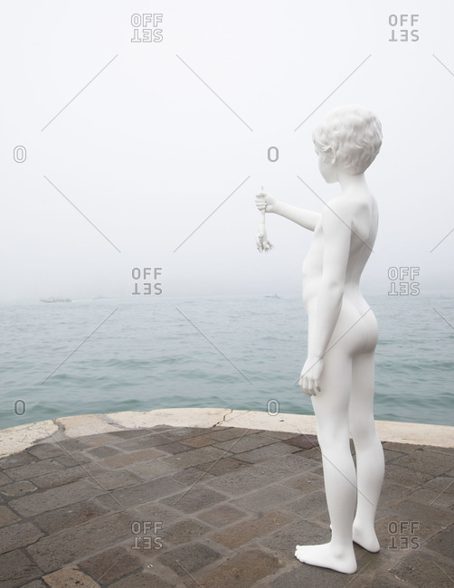 January 13, 2013 - Venice, Italy: Boy with Frog, a statue by Charles Ray at the Punta Della Dogana