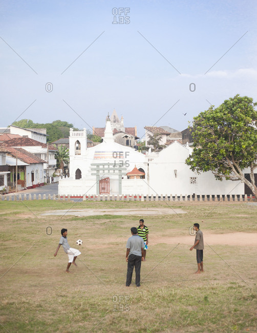 Galle, Sri Lanka - Feburary 22, 2012: Locals playing soccer in the yard