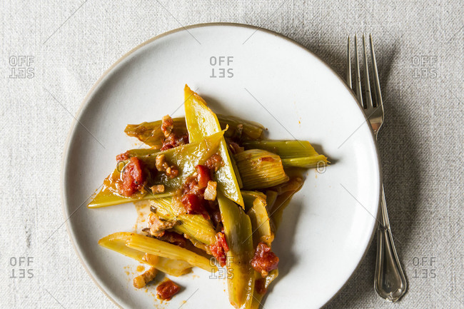 Braised celery with onion pancetta and tomatoes