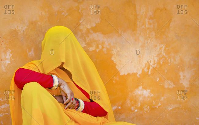 Woman hiding behind sari, Amber Palace, Jaipur, India