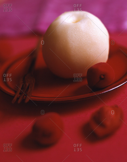 Peeled Asian pear with some exotic berries