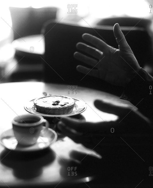 Man gesturing in cafe