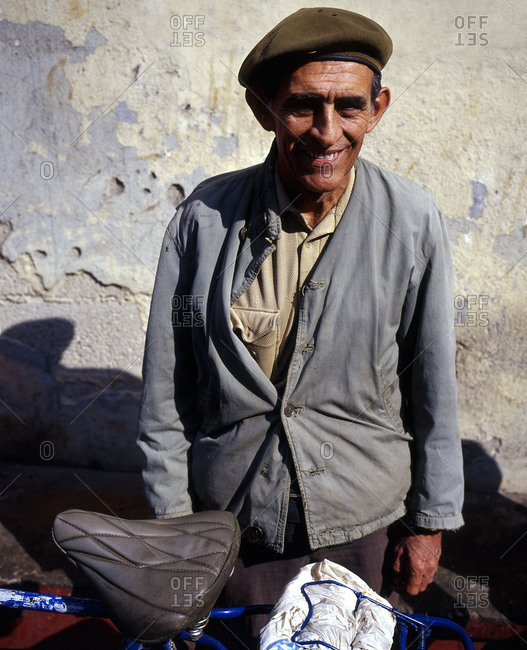 Portrait of man in beret looking into camera
