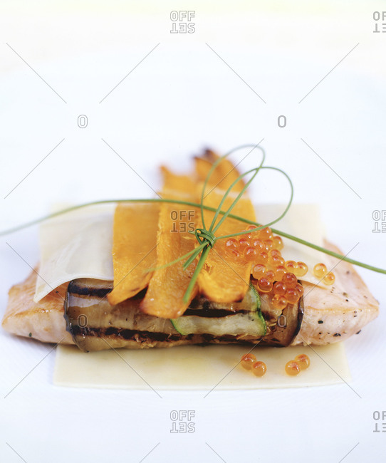 Fish fillet wrapped in sliced aubergine and zucchini, decorated with butternut squash and roe