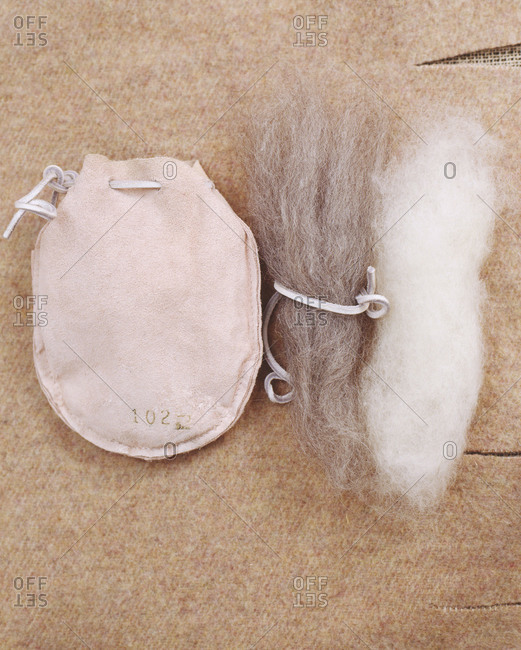 Leather pouch with bunches of wool