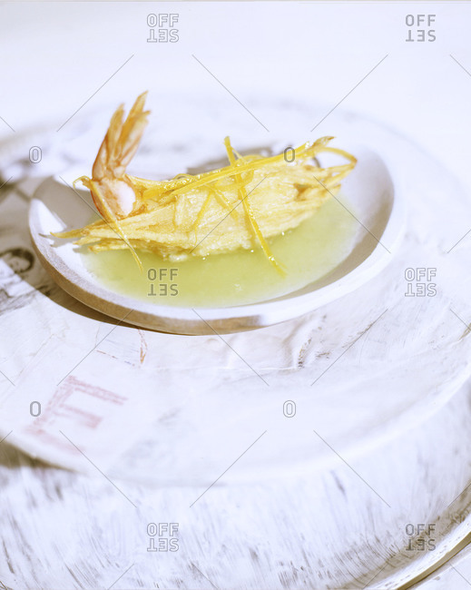 Fried prawn served on a white plate
