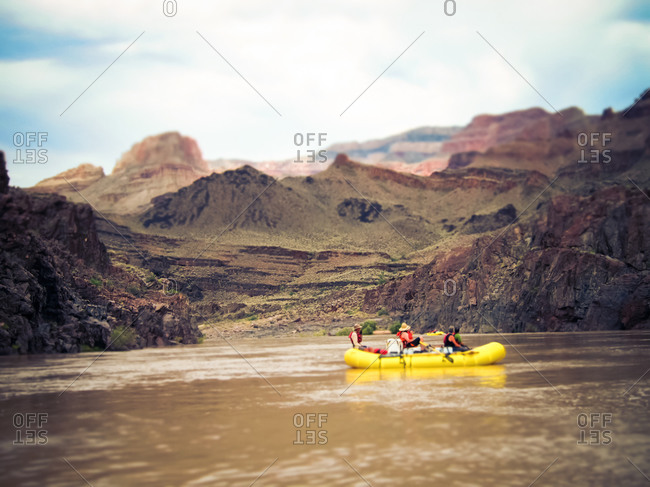 Tourists in a raft explore Grand Canyon