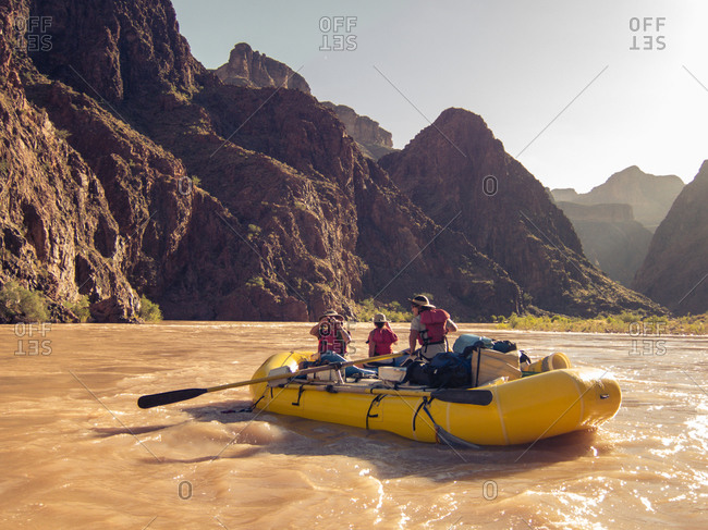 Tourists in an inflatable boat explore Grand Canyon