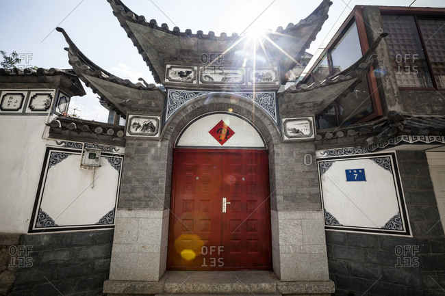 Dali City, Yunnan, China - April 13, 2014: Exterior of Chinese residence seen from street.