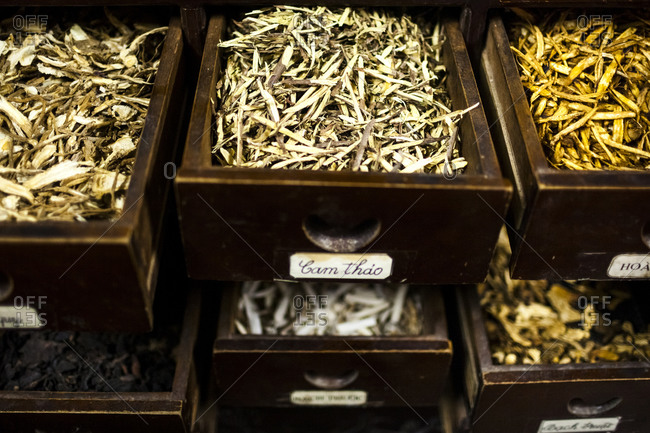 Different types of dried roots, used in traditional herbal medicines, in cabinets at a pharmacy, Hanoi, Vietnam.