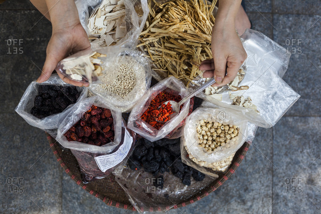 A street side store selling various herbs and roots used in traditional medicine on Lan Ong street in Hanoi's Old Quarter, Vietnam.