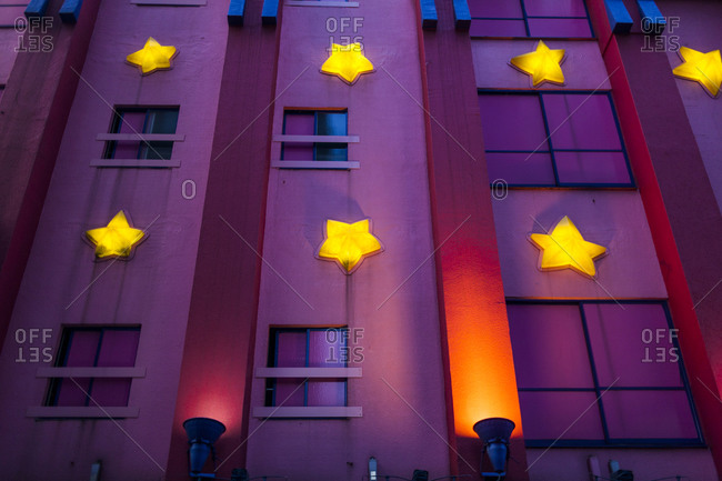 "Decorative lights and stars on the side of a classic ""love hotel"", Osaka, Japan."