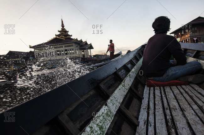 Inle Lake, Shan State, Myanmar - October 22, 2012: A long boat makes its way down Inle Lake in Shan State, Myanmar.