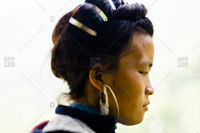 Sapa, Vietnam - September 2, 2013: Portrait of a young Hmong woman in Sapa, Vietnam.
