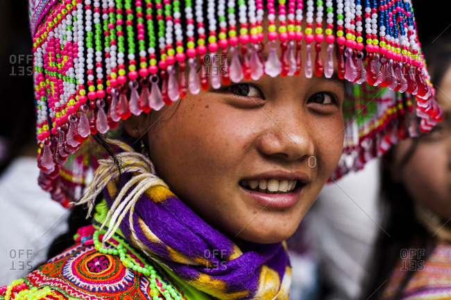 Bac Ha, Northern Vietnam - May 31, 2008: A Flower Hmong girl dresses up for the Sunday market in Bac Ha, northern Vietnam.