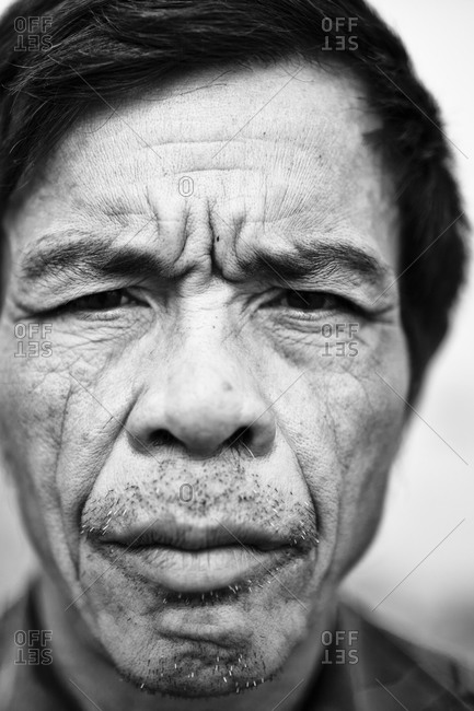 Hanoi, Vietnam - December 21, 2011: Portrait of a farmer in Hanoi, Vietnam.