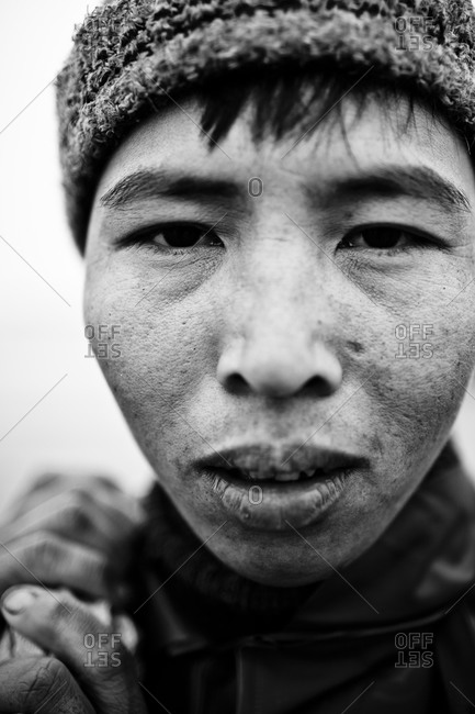 Xuan Thuy, Vietnam - December 9, 2011: Portrait of a fisherman, Red River Delta, Xuan Thuy, Vietnam.