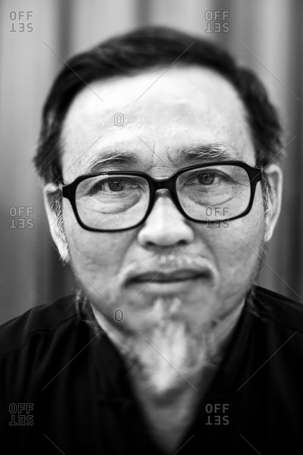 Hanoi, Vietnam - April 21, 2012: Portrait of a Vietnamese calligraphy scholar, Hanoi, Vietnam.