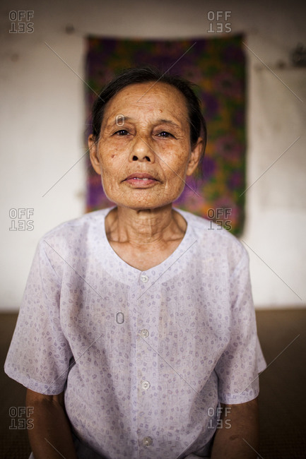 Nam Dinh, Northern Vietnam - October 18, 2011: Portrait of an elderly Vietnamese woman at her home in Nam Dinh, Northern Vietnam.