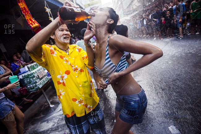Bangkok, Thailand - April 13, 2011: Two women drenched in water as crowds celebrate Songkran, the Thai New Year, Bangkok, Thailand.