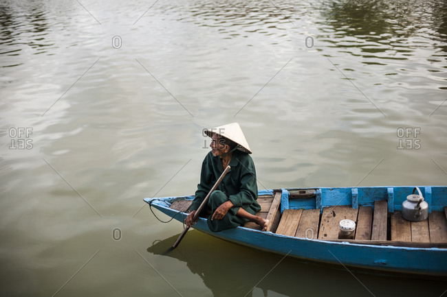 Hoi An, Vietnam - September 5, 2008: An old man on the Thu Bon river in Hoi An, a UNESCO-recognized heritage town, central Vietnam.