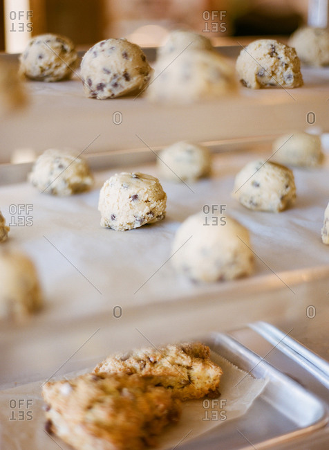 Raw chocolate chip cookie dough balls prepared for baking