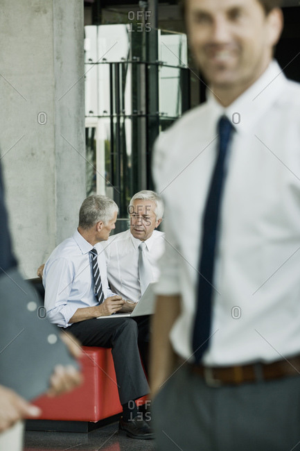 Two businessmen with laptop