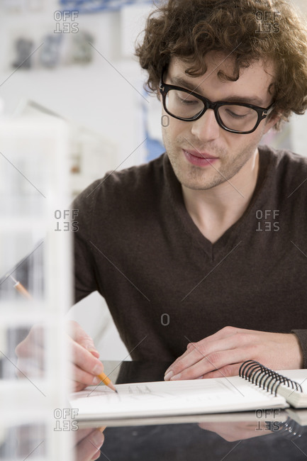 Portrait of young architect working in his office