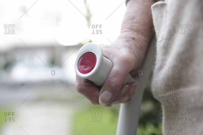 Hand of senior woman on a crutch
