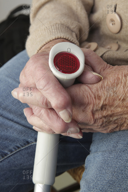 Hands of senior woman on a crutch