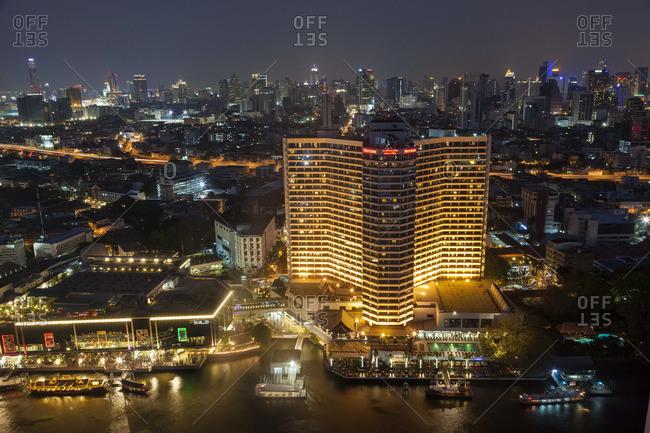Chao Phraya River and skyline at dusk, Bangkok, Thailand