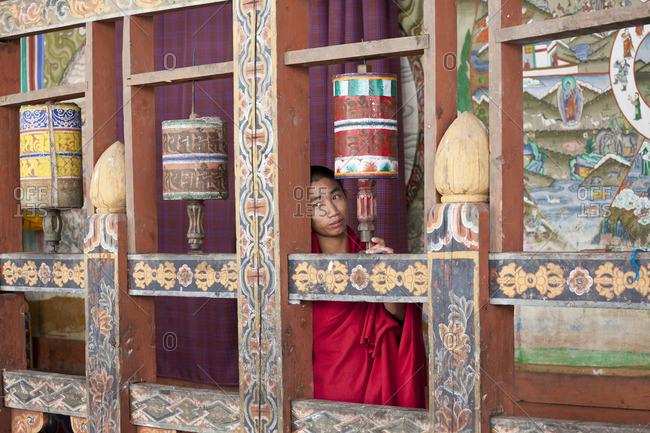 - October 6, 2011: Monk spinning prayer wheels in Buddhist monastery, Tongsa, Bhutan