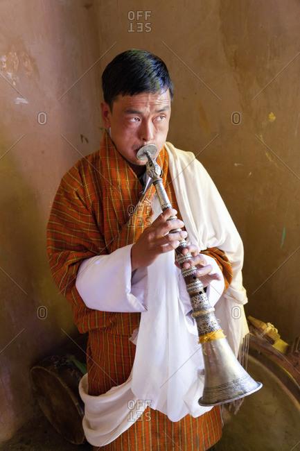- October 10, 2011: Blowing a horn backstage, at Tsechu Festival, Gangtey Monastery, Phobjikha Valley, Bhutan