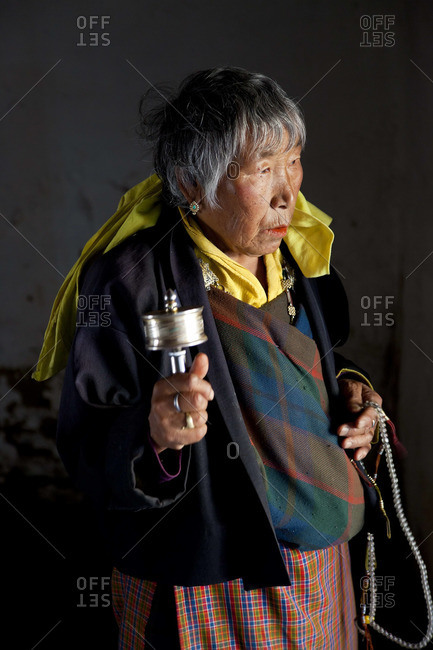 - October 9, 2011: Woman with prayer wheel, Jampey Lhakhang Dzong, Jakar, Bumthang Valley, Bhutan