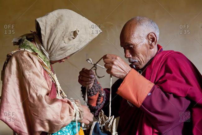 - October 10, 2011: Monk helping performer at Tsechu Festival, Gangtey Monastery, Phobjikha Valley, Bhutan