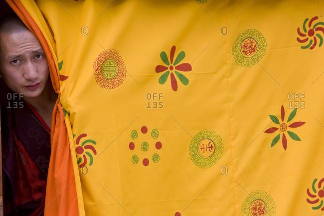 - October 11, 2008: Man peeking out at Tsechu Festival, Gangtey Monastery, Phobjikha Valley, Bhutan