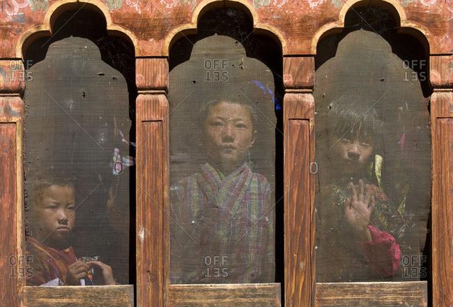 - October 14, 2008: Children at window watching festival, Thangbi Mane Festival, Tangbi Goemba, near Jakar, Bumthang, Bhutan