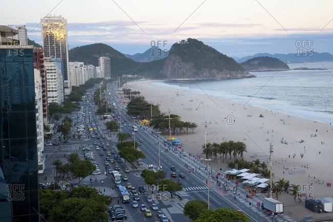 View of Copacabana Beach, and Avenue Atlantica at dusk, Copacabana, Rio de Janeiro, Brazil