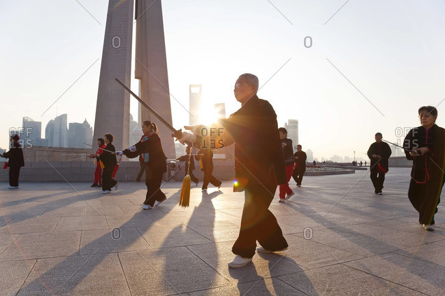 - January 17, 2012: People practicing Tai Chi in the early morning at The Bund, Shanghai, China