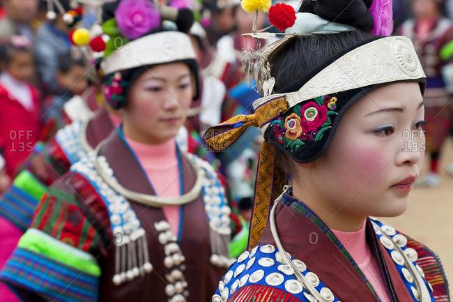 - January 26, 2012: Black Miao girls at a festival, Kaili, Guizhou Province, China