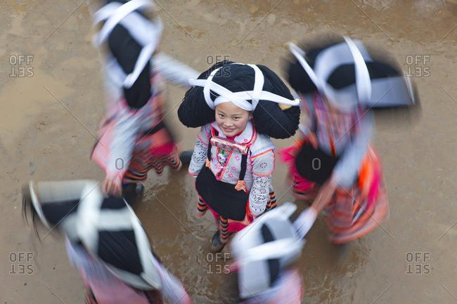 - January 31, 2012: Long Horn Miao girls dancing, Sugao, Guizhou Province, China