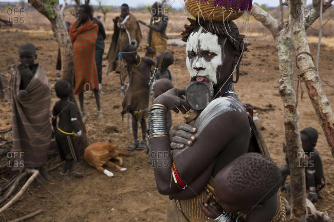 - January 23, 2009: Mursi woman with her child in Omo Valley, Ethiopia