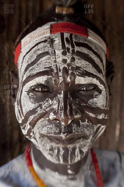 Portrait of a Karo tribesman with body paint, Omo Valley, Ethiopia