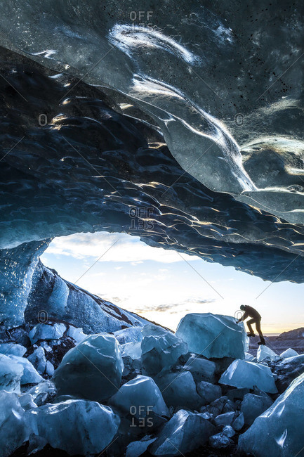 Person standing in a glacial ice cave at Skaftafell National Park, Iceland